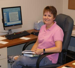 kristi kneas at her desk