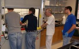 Dr. Rood and Dr. Schaeffer work with students in the research lab
