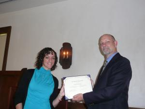 dr. louis martin giving award to student
