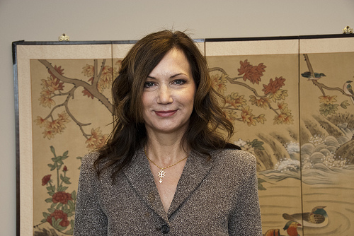 dr catherine lemley in front of floral painting