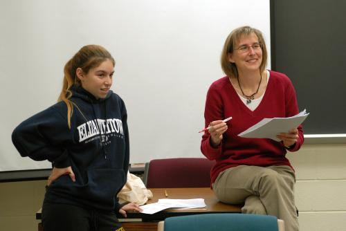 susan mapp with student in front of classroom