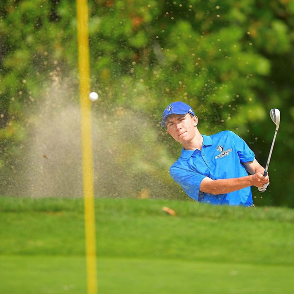 student playing golf