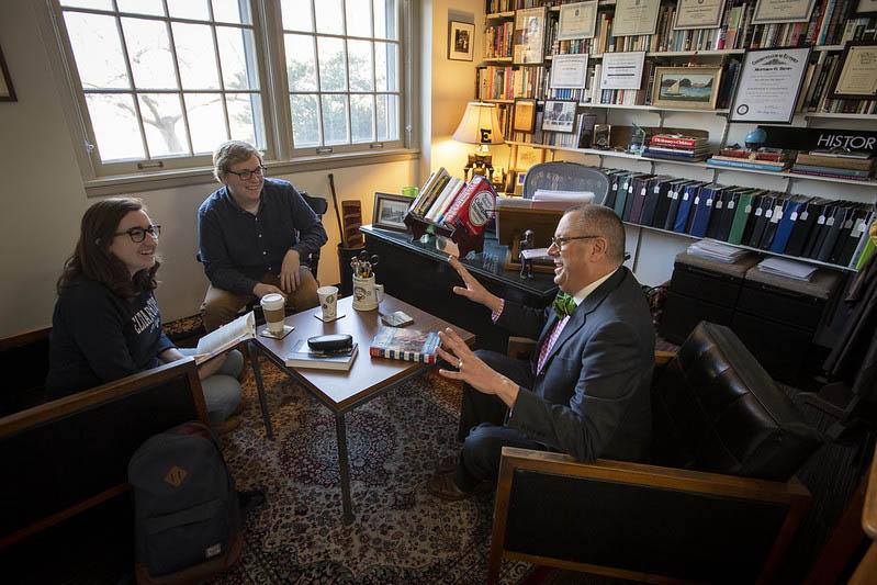 graduate students talking to a professor