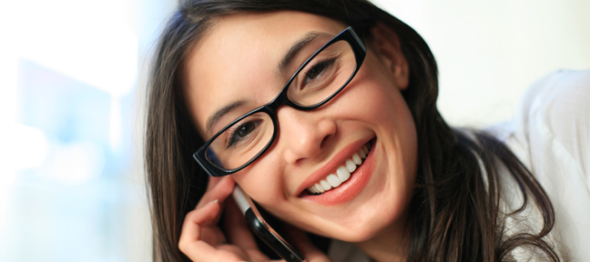 Person smiling and talking on phone
