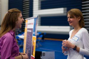Student talking with recruiter at job fair
