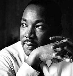 collage of martin luther king and civil rights photos with focus on martin in a thinking post