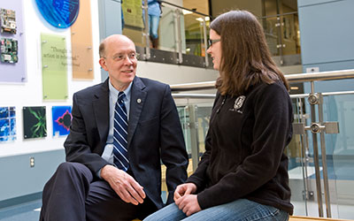 President Strikwerda talking with a student