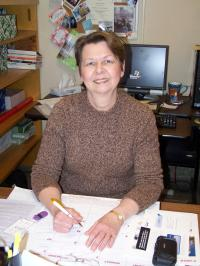barb shank at her desk