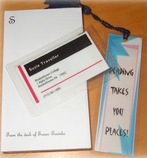 sample of novelty items including luggage tag and bookmark