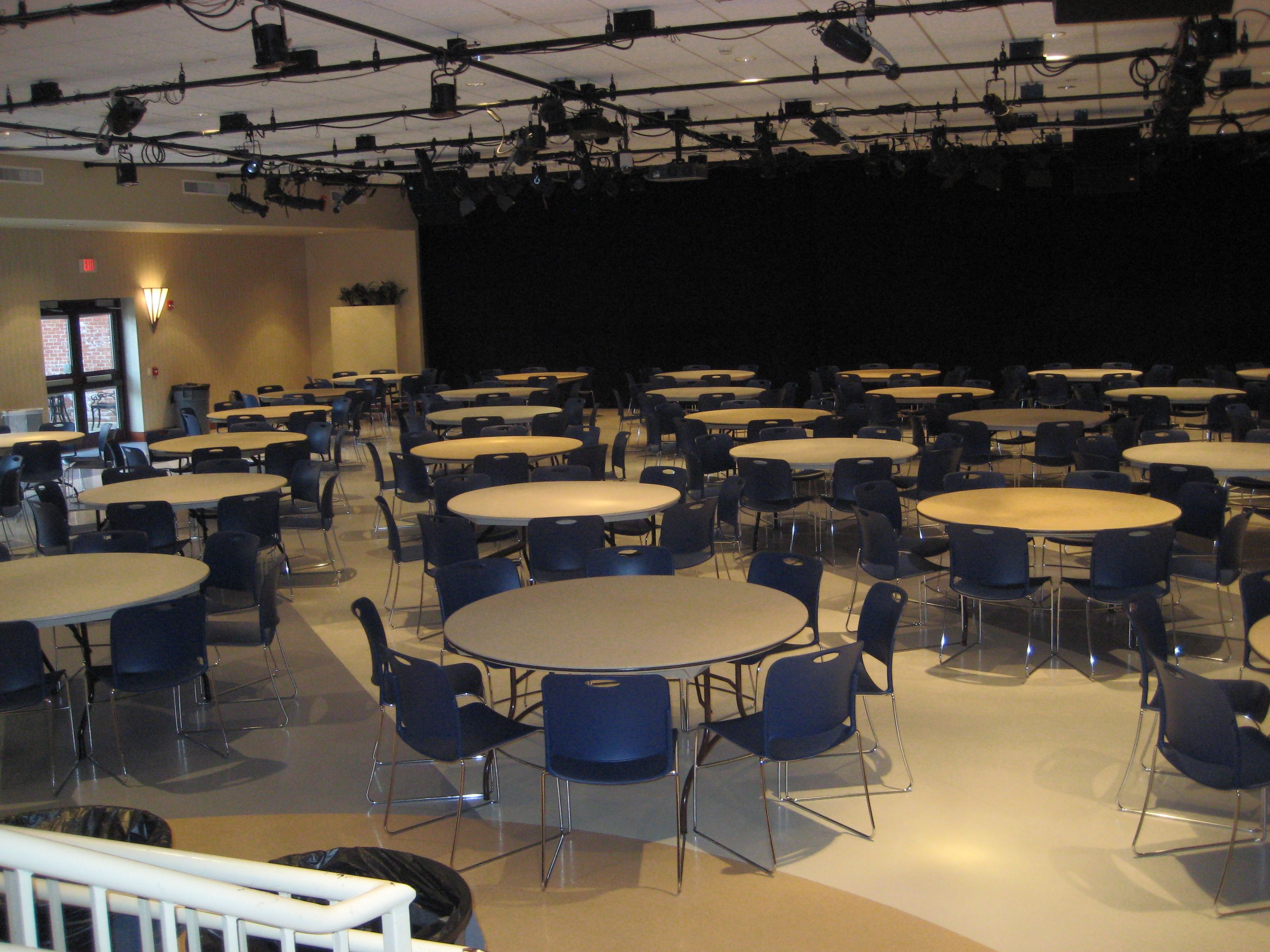 the kav set up for a banquet with round tables