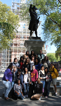 momentum students on philly field trip in front of colonial figure statue