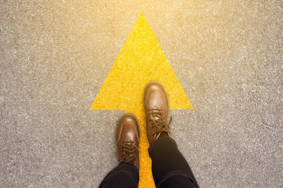 Yellow arrow with feet